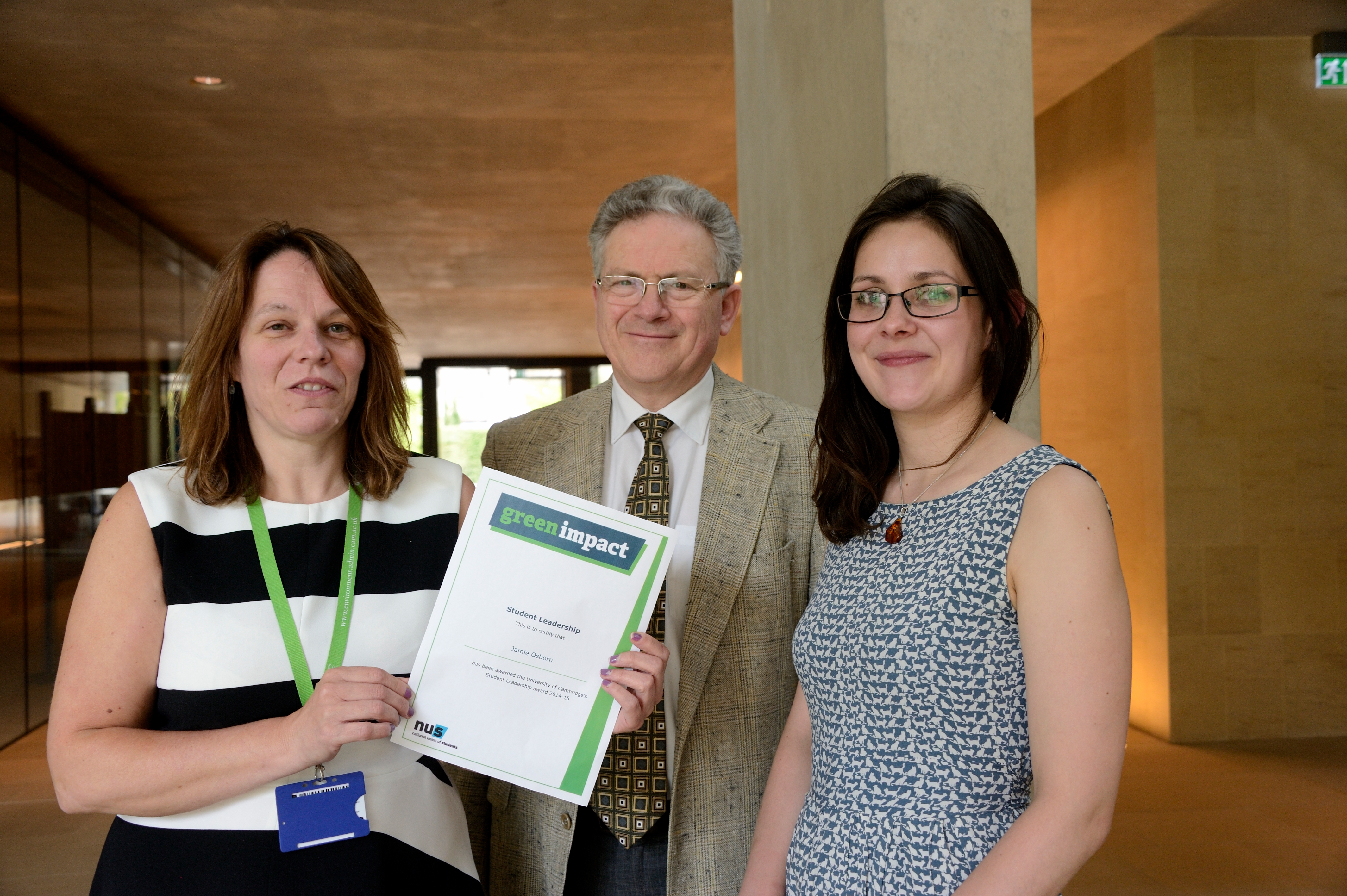 Deborah Hoy from Clare College collecting the award on behalf of Jamie Osborn, winner of the Student Leadership Award, with Professor Jeremy Sanders, Pro-Vice-Chancellor of Cambridge University and Leila McElvenney, Environment and Energy Section